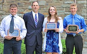 Athletes of the Year Ian Chedzoy (left), Gillian Clark and Patrick Hazlitt pose with Mike Stamp of E.C. Cooper Insurance, which sponsors the awards.